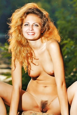 Adorable Izabel proudly reveals her natural bush.