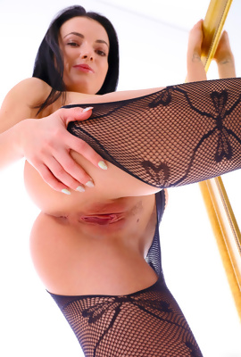 Sapphira is pure beauty who seduces in fishnets