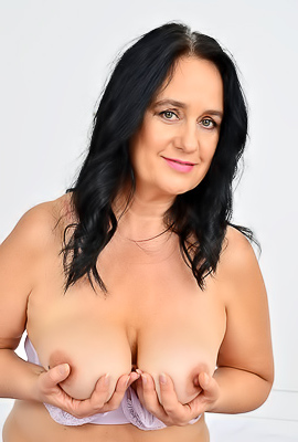 Ria Black Busty brunette milf Ria Black shows off her flabby body