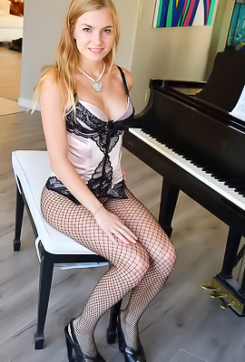 Angelina FTV Angelina FTV rides a dildo when playing a piano