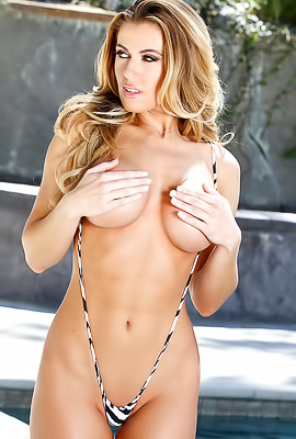 Huge boobed pornstar Randy Moore nude by the pool